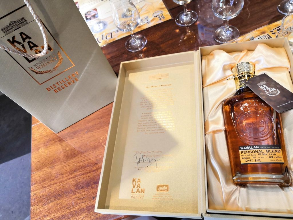 After bottling, corking and sealing your personal Kavalan whiskey, you label it and sign off on the box.